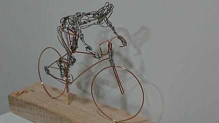 Wire sculpture of a man on a bicycle