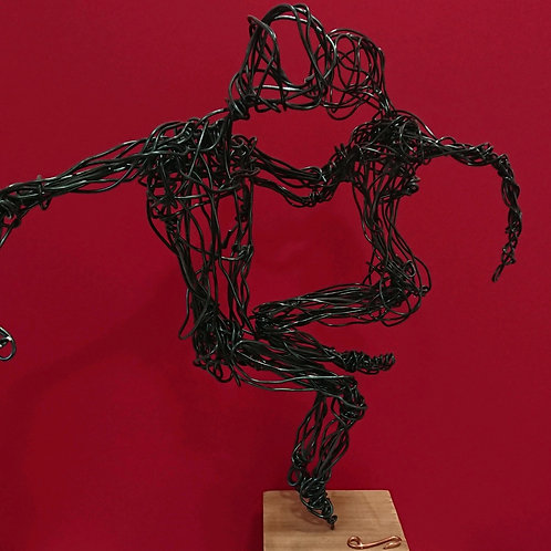 Wire sculpture of dancing couple.