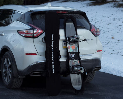 Board Bootie leaning on SUV