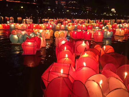 Floating the lamps on the river and wish all the best in Ziyuan