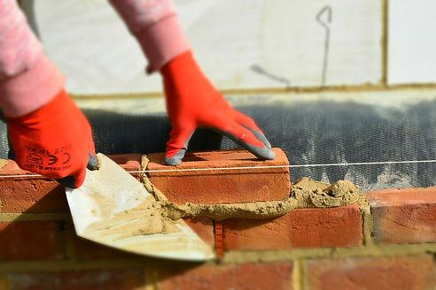 A man laying bricks