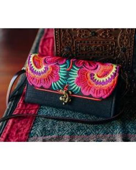The Lemonade Boutique Hibiscus Embroidered Crossbody Wallet.