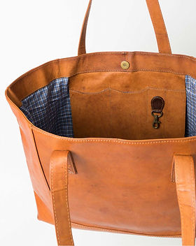 Noonday modern leather tote. https://juliegodshall.noondaycollection.com/shop/modern-leather-tote/