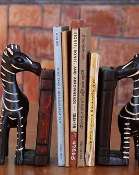 Azizi Life hand caved zebra bookends.  Fair trade and handmade in Rwanda. https://azizilife.com/products/#home