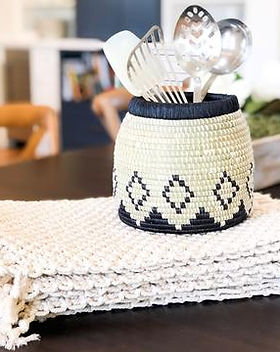 HUGG Mission Market utensil holder and macrame placemats.  Handmade in Haiti and providing jobs to young men coming out of orphanages. https://huggmissionmarket.org/collections/home-collection