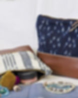 Education and More fair trade cosmetic bag. Upcycled and eco-friendly. https://www.educationandmore.org/collections/fair-trade-purses-and-bags/products/fair-trade-ikat-and-leather-cosmetic-bag