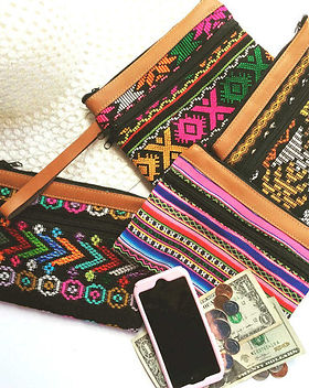 Education and More fair trade wristlets made in Guatemala. https://www.educationandmore.org/collections/fair-trade-purses-and-bags/products/eco-wristlet-wallet-bag-leather-upcycled-fabric