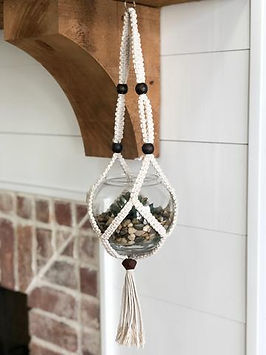 HUGG Mission Market hanging macrame planter. Handmade in Haiti. https://huggmissionmarket.org/collections/home-collection