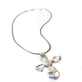 Vineworks cross necklace. Made in Haiti out of upcycled materials https://www.vineworks.gives/search?q=cross