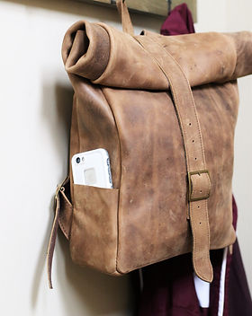 Lazarus Artisan Goods leather backpack. Etically made in Haiti.  Sold through Give a Damn Goods. https://giveadamngoods.com/collections/shop-ethical-bags-and-backpacks/products/alejandro-leather-backpack