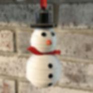 Papillon recycled cereal box fair trade snowman ornament.