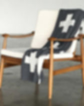 Give a Damn Goods Cross Throw Blanket. Affordable ethical goods making a a difference. https://giveadamngoods.com/collections/shop-sustainable-home-goods