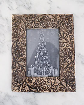 Bought Beautifully  hand carved wooden frame.