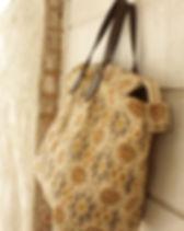 Persona Grata Goods wayfarer desert rose carpet bag. Made in the USA by refugee moms.