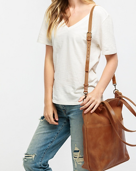 Adored Boutique crossbody leather tote. https://www.adoredboutique.com/products/chaltucrossbodytote