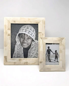 hope.market photo frames. Made in Haiti out of ethically-harvested carved bone. https://hope.market/