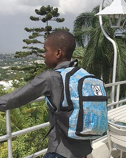Market Haiti Backpack. Eco-friendly and ethically-made from recycled water bottles. https://markethaiti.com/collections/gifts/products/backpack-recycled-water-bag-design