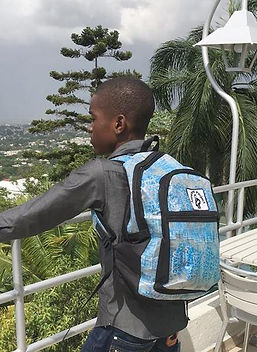 Market Haiti eco-friendly backpack.  Made in Haiti from recycled water bottles. https://markethaiti.com/collections/gifts/products/backpack-recycled-water-bag-design