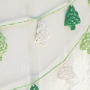 Above Rubies Christmas Tree Garland. Hand crocheted in the Phiippines.