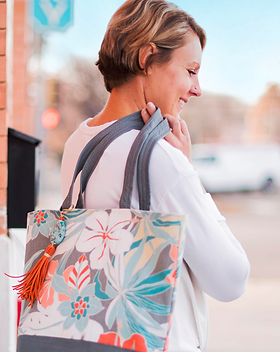 Vi Bella paradise floral tote with leather tassel and accents.