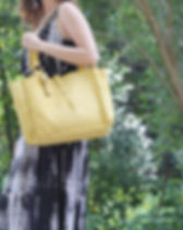 2nd Story Goods sheepskin pale yellow tote. Ethically made in Haiti.