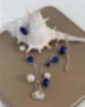 Nightlight Design seaside ankle bracelet with shell. https://store.nightlightinternational.com/product_p/fb001.htm