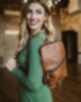 Amma's Umma leather backpack. Ethically made and gives back to adoptions. https://ammasumma.com/search?q=backpack
