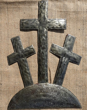 Anchored in Hope Easter Three Crosses Metal Wall Art. https://anchoredinhopehaiti.com/collections/scripture-metal-art/products/3-crosses-on-the-hill-20x14