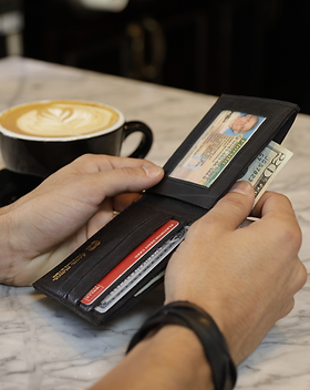 Deux Mains Sustainable Leather and Inner Tube Wallet. Handcrafted in Haiti.