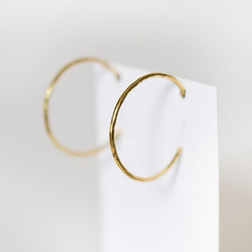 Karama Collection hammered hoops earrings. Handmade in Kenya out of upcycled brass.