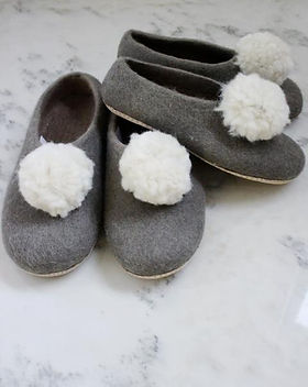 Bought Beautifully pom-pom wool slippers. Hand felted by women artisans in Nepal. https://boughtbeautifully.org/collections/gifts-and-more/products/pom-pom-slippers