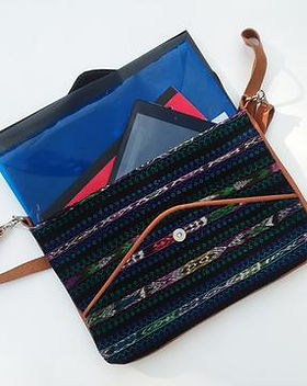 Education and More mini messenger bag. Fair trade. https://www.educationandmore.org/collections/fair-trade-purses-and-bags/products/ethical-large-clutch-bag-with-ikat-leather