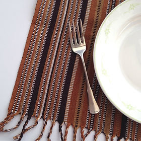 Education and more Thanksgiving napkin set. Fair trade and handwoven in Guatemala. https://www.educationandmore.org/collections/kitchen-linens/products/handwoven-cloth-napkins-rustic-and-tribal-brown-stripe-textiles-set-4