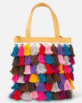 Noonday La Gloria colored tassel tote. https://juliegodshall.noondaycollection.com/shop/bags/