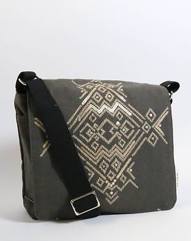 Renew Project messenger bag. Made in the USA by refugee women. https://www.renewproject.org/search?q=messenger