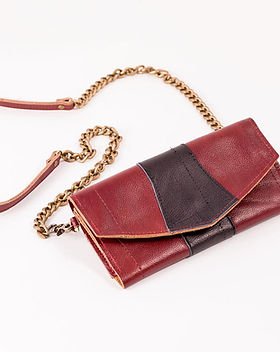 Rethreaded Crossbody Wallet. Made from upcycled leather airline seats and helps support the fight against human trafficking.
