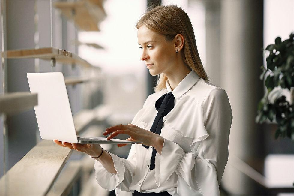 focused-worker-using-laptop-in-office-lobby-4173263_edited.jpg
