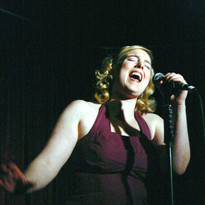 Belting like a champ in some moody lighting at my cabaret performance