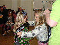 Retiring Junior Queen awarding new Junior Princess sash