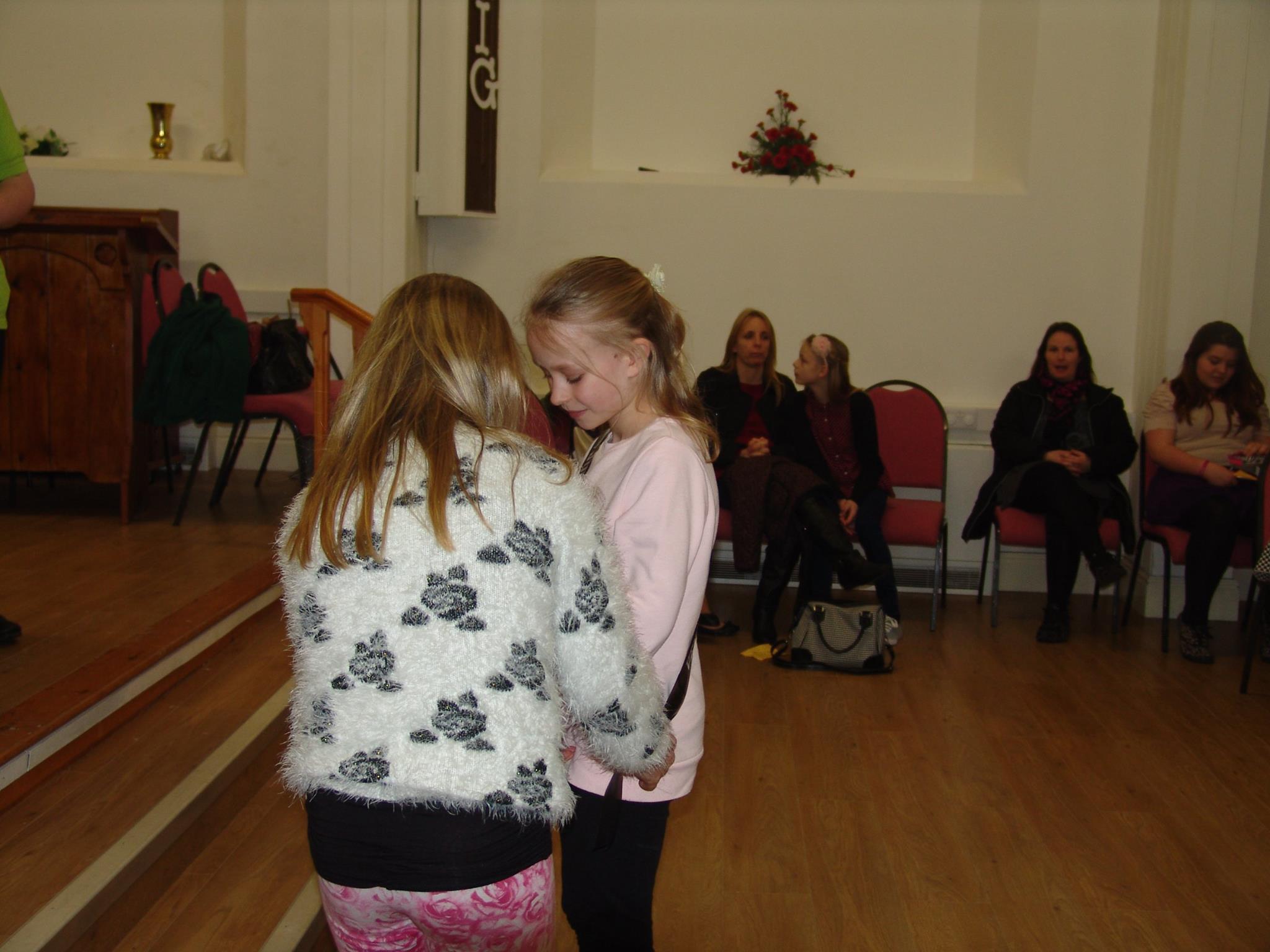 Retiring Junior Queen awarding new Junior Princess sash