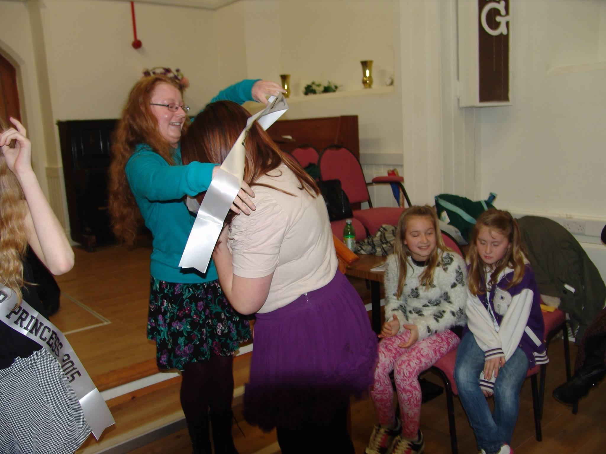 Retiring Queen awarding the new Senior Queen sash