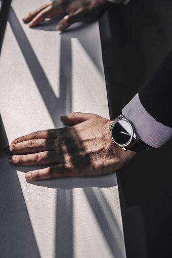 mans-hands-lean-on-ledge.jpg