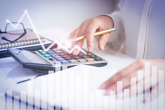 accountant-calculating-profit-with-financial-analysis-graphs.jpg