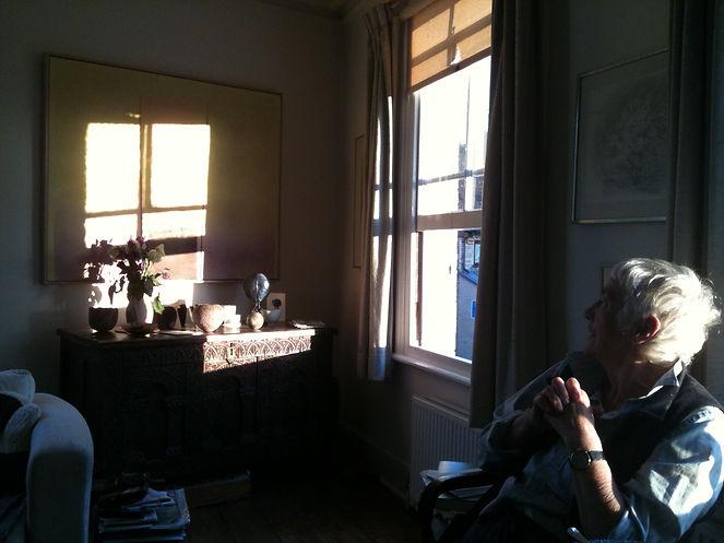 Julia Ball looking at a still life scene