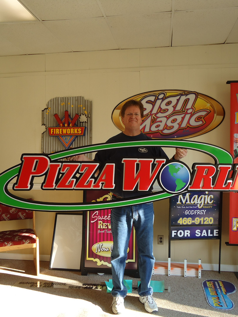 Pizza World sign with Steve