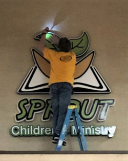 Steve Installing Sprouts Sign - Edited f