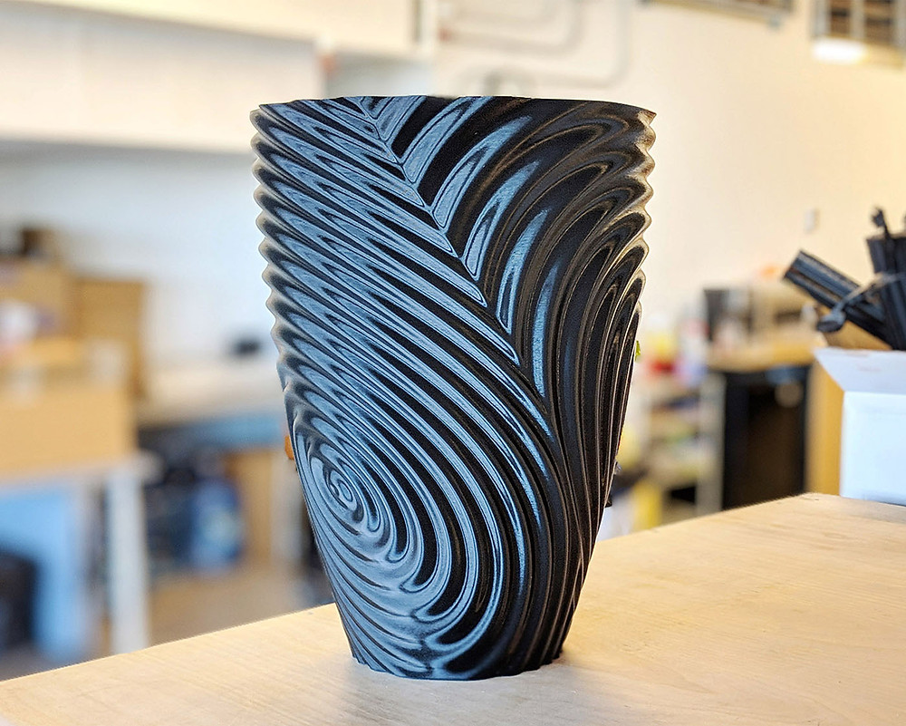 gMax Twisted Ripple Vase model available for free download on Cults3D.