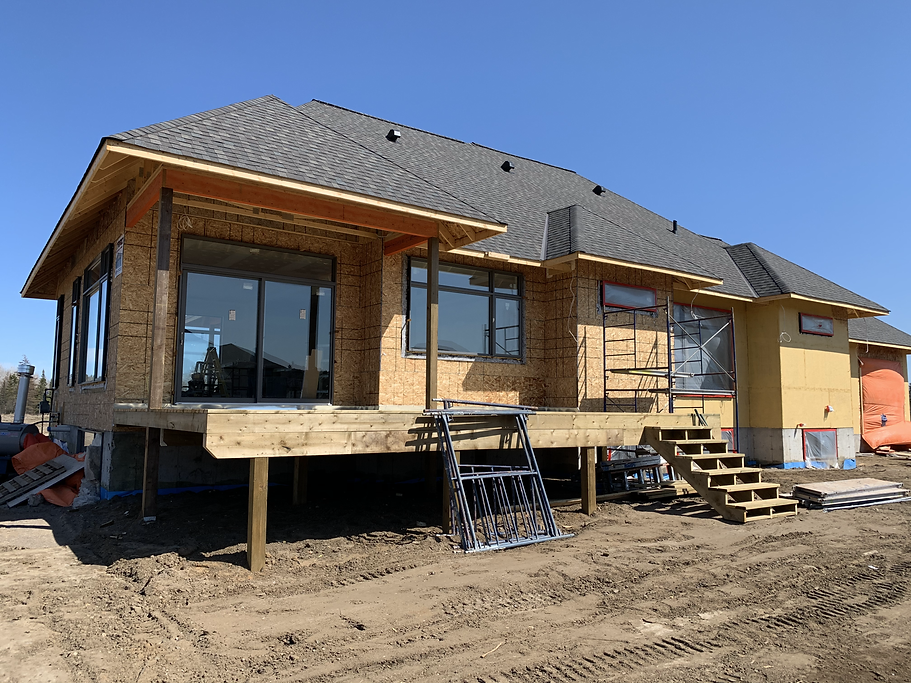 Construction home that has shingles. Roofing shingles are on the home