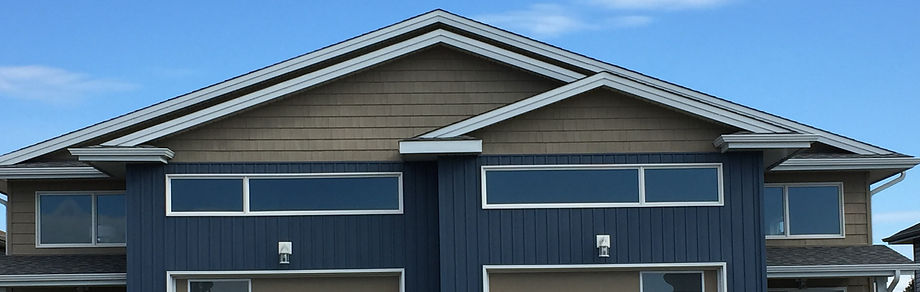 Roof with shingles, business and home with roofing shingles