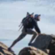 photo of man climbing mountain_edited.jpg